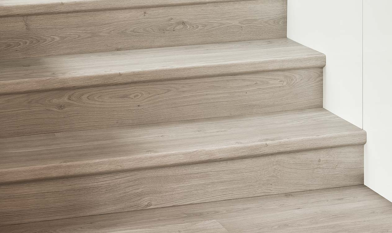 Finish you staircase to match your floor with Quick-Step® Incizo technology.