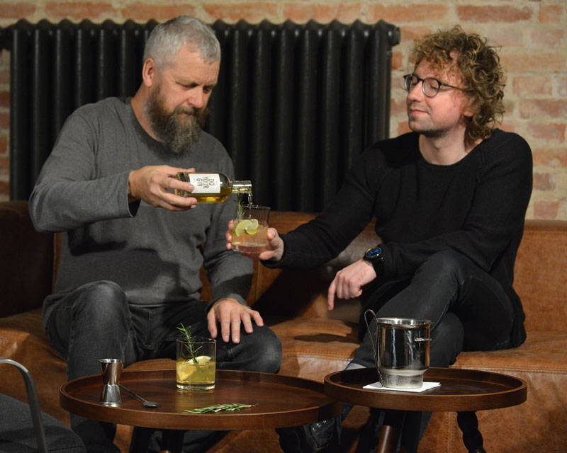 Two men sharing gin cocktails