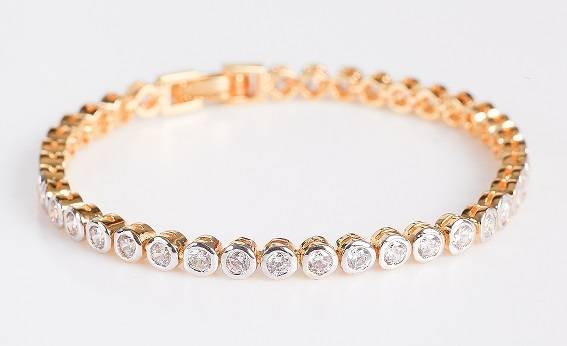 Line bracelet with round brilliant cut diamonds rubover set from Pobjoy Diamonds
