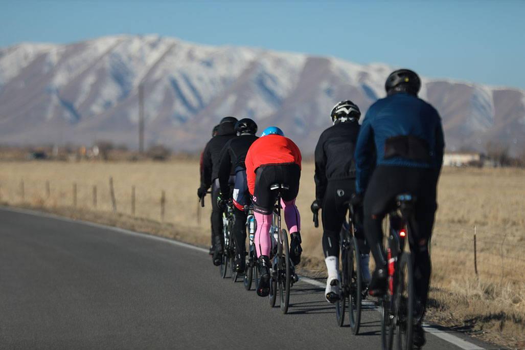 small group biking towards mountainscape