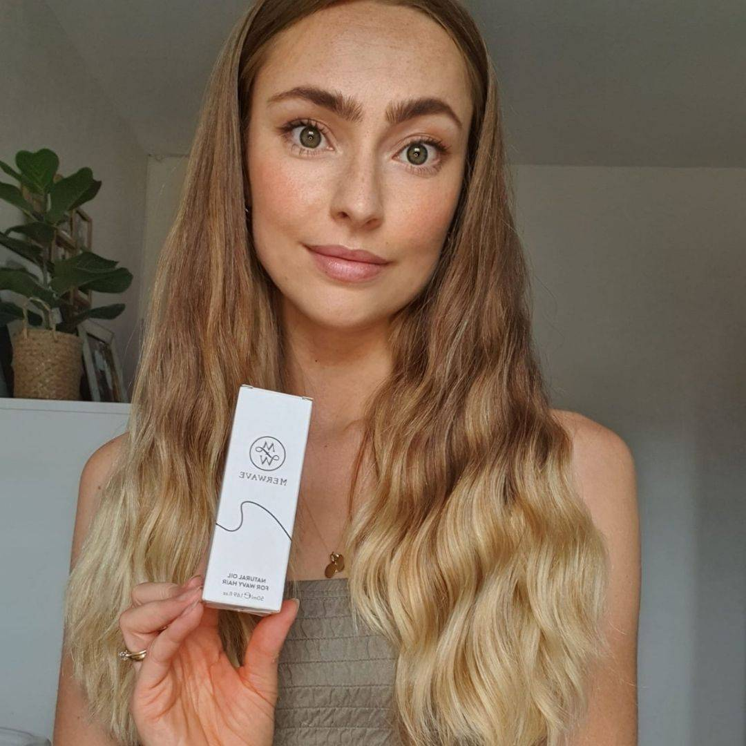 Photo of women holding wavy hair oil