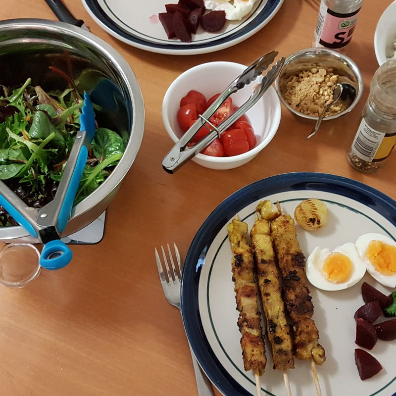 Salad with beetroot, egg, tomato and crushed peanuts and a side of rice cooked with sultanas.
