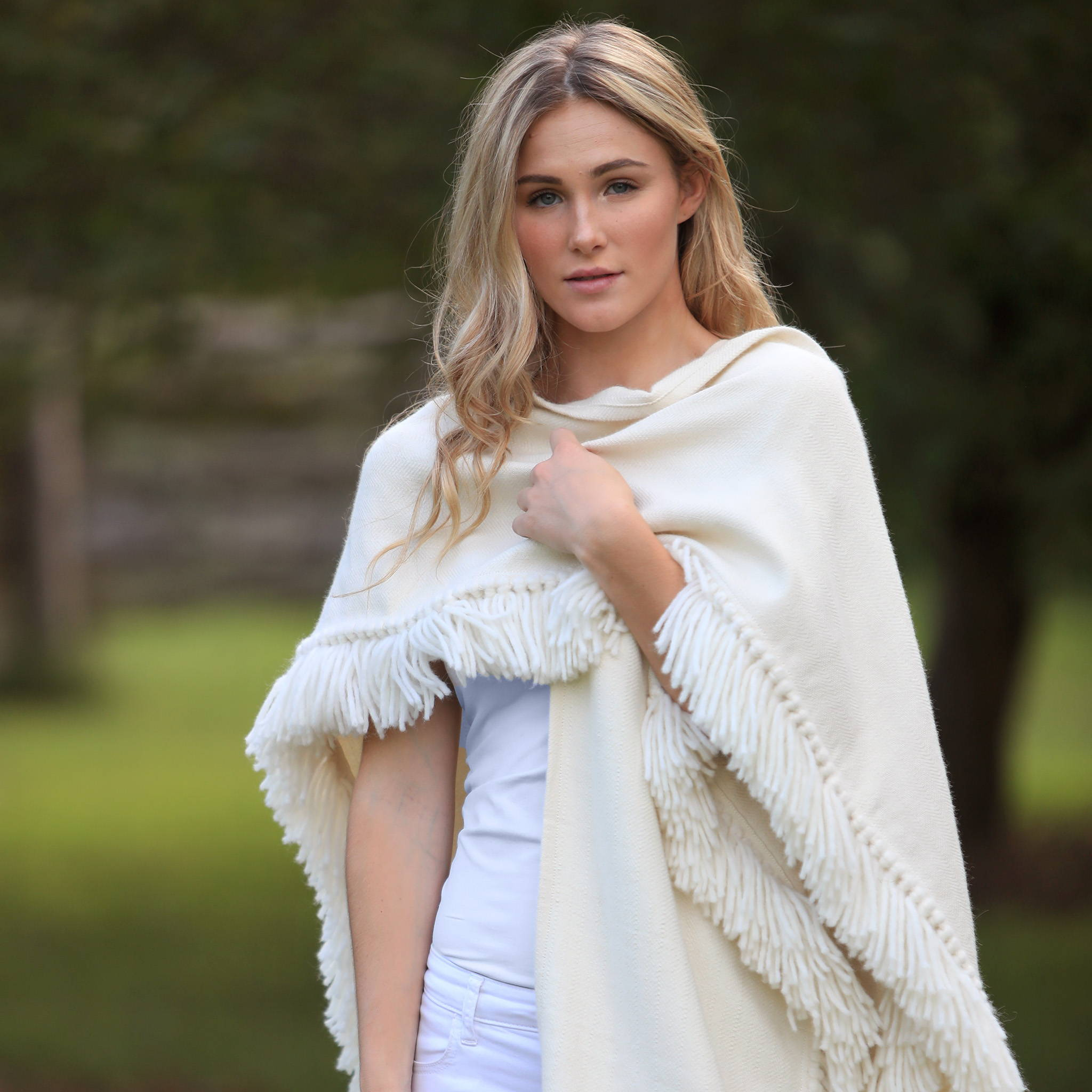 Woman wearing handwoven Fringed Alpaca Ruana Wrap in winter white - Stick & Ball