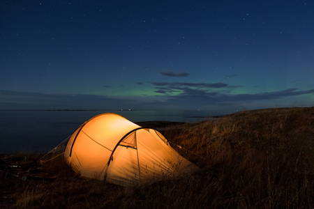 Illuminated tent in front of the Atlantic coast in Norway.jpg