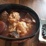 Wonton in beetroot mushroom soup