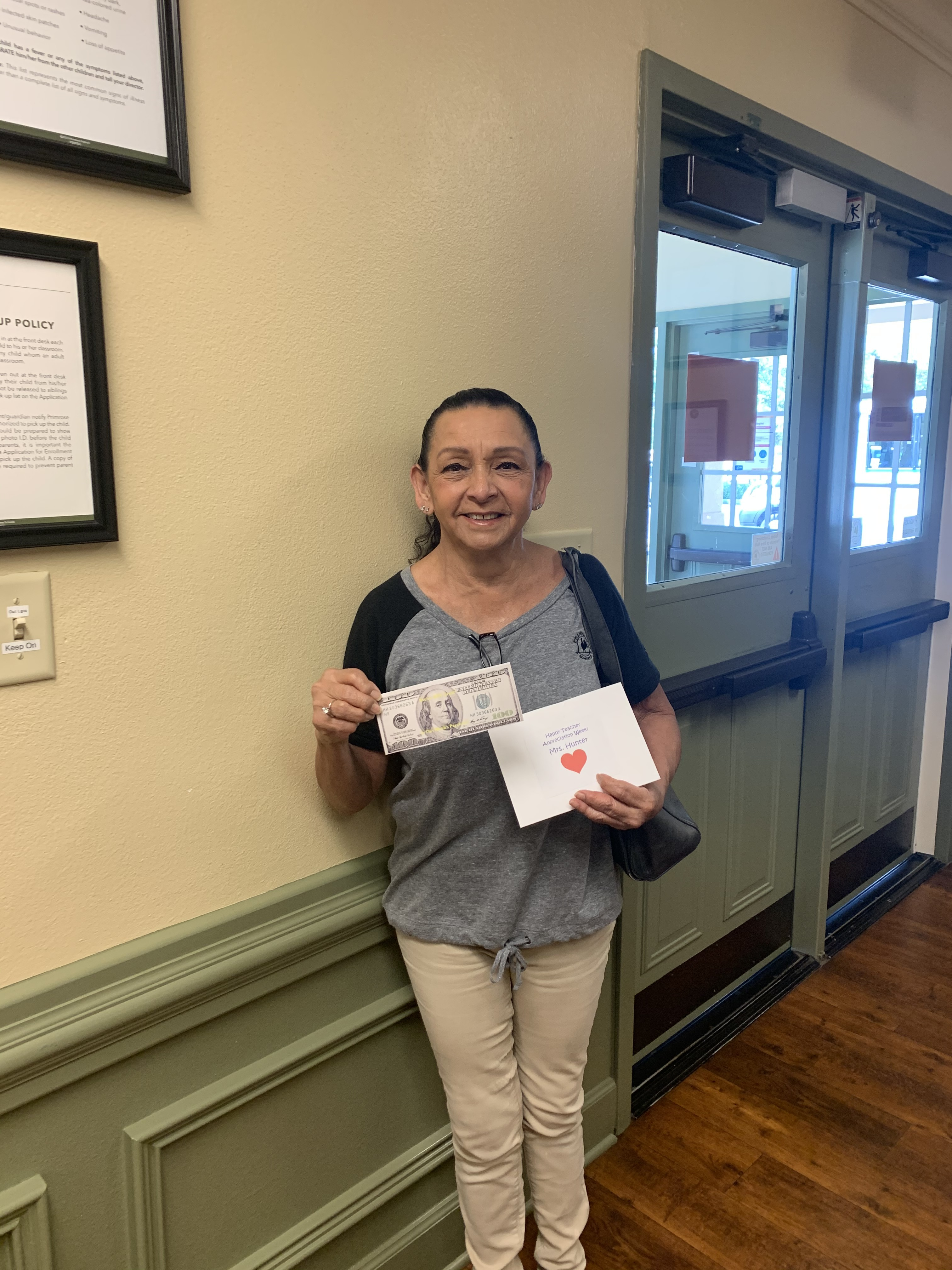 Photo of Mrs. Hunter with her $100 Teacher Appreciation Bonus
