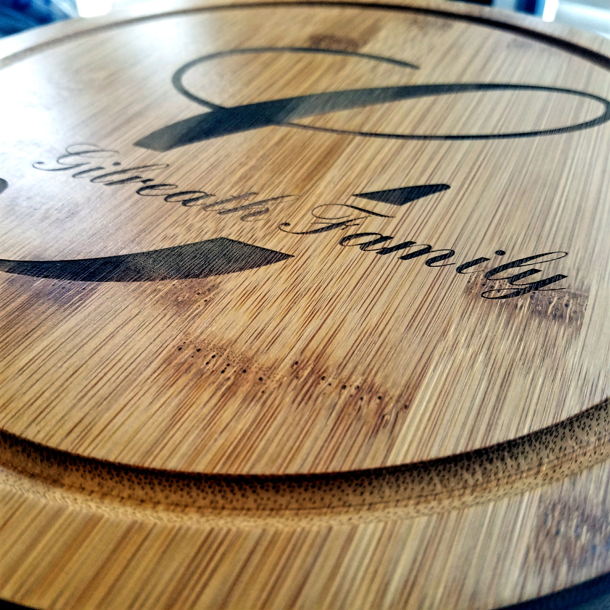 custom engraved cheese board with monogram and last name