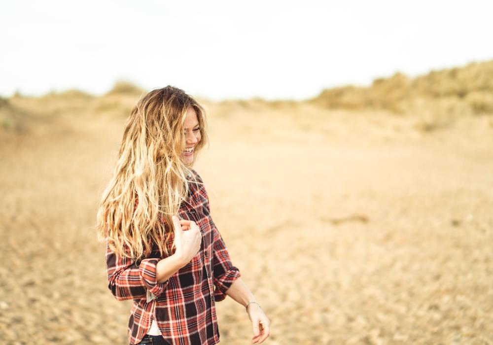 Image of wavy hair women on beach