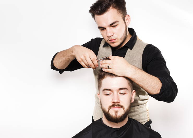 stylist cutting man's hair