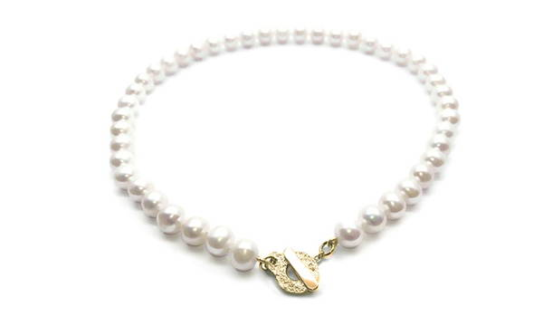 Pearl necklace with yellow gold attachment titled timeless