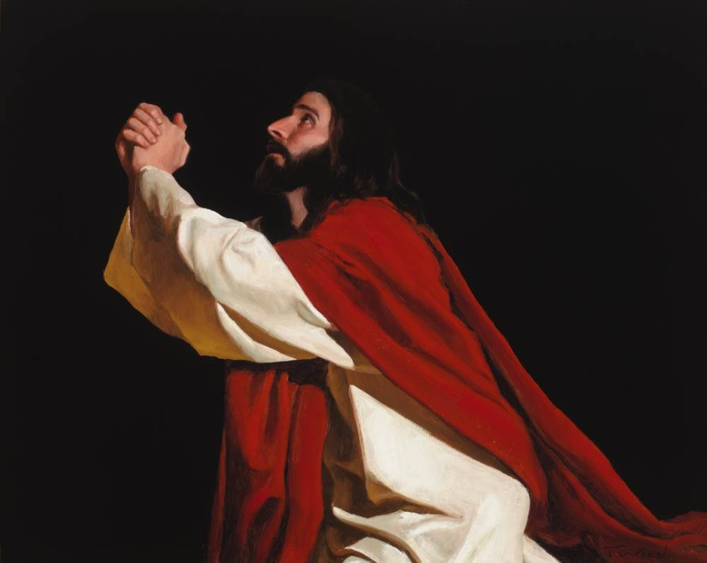 LDS art painting of Jesus praying. He wears a red robe and looks earnestly toward Heaven.