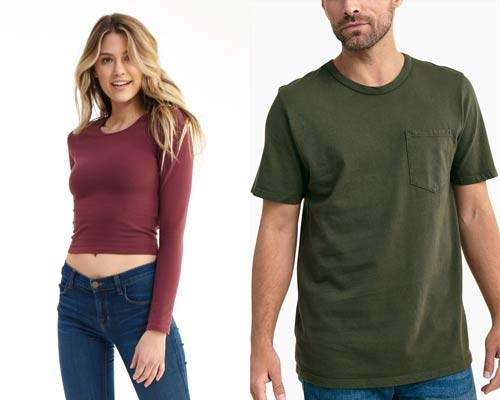 Woman wearing Groceries Apparel organic cotton long sleeve burgundy crew neck cropped top and man wearing olive green relaxed fit short sleeve t-shirt