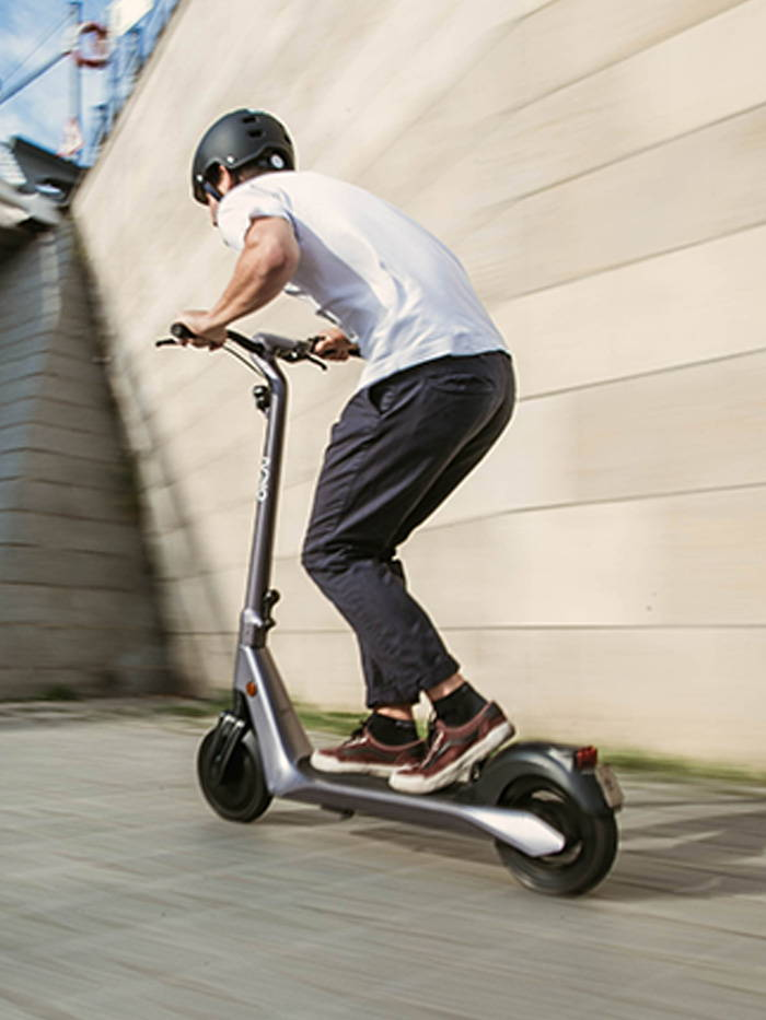 Okai Electric Scooter & Electric Bike Manufacturer, ES500 Electric Scooter Front View Racing motion blurred picture