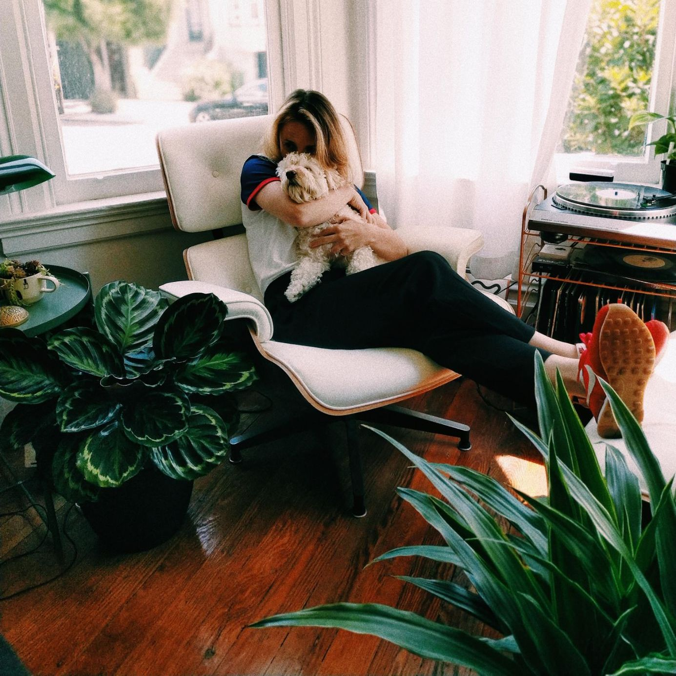 woman relaxing at home with dog
