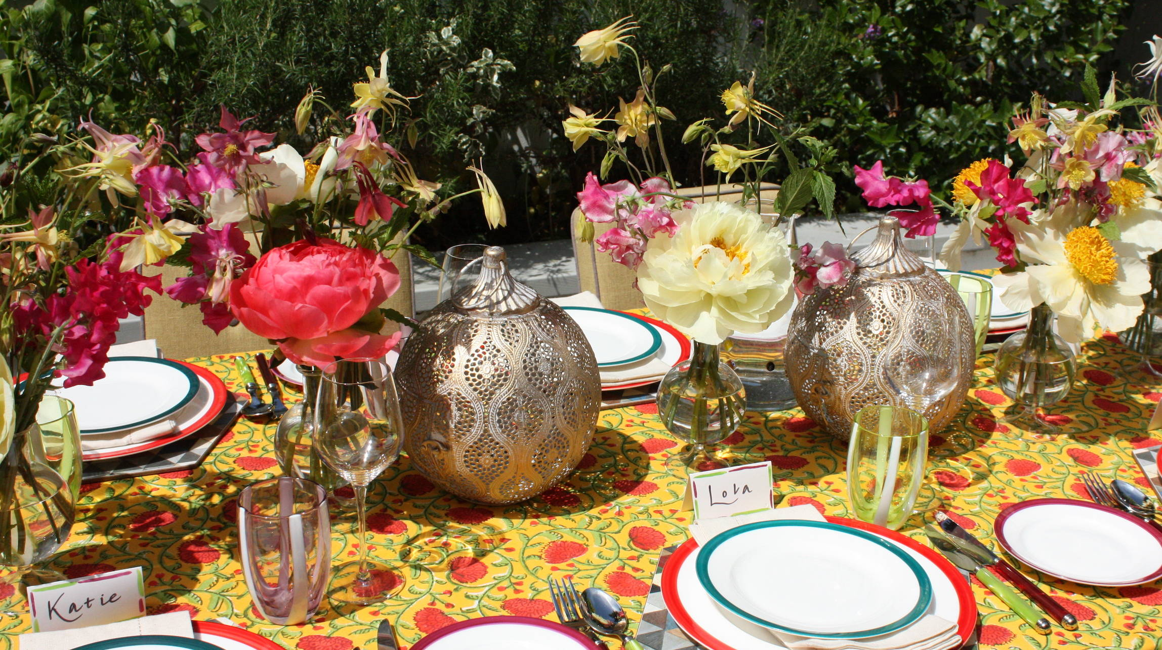 Bright fiesta themed tablescape with beatiful fresh flowers