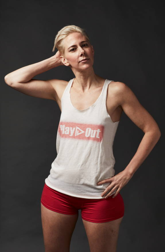 Model wears play out logo tank top and red boxer briefs underwear.