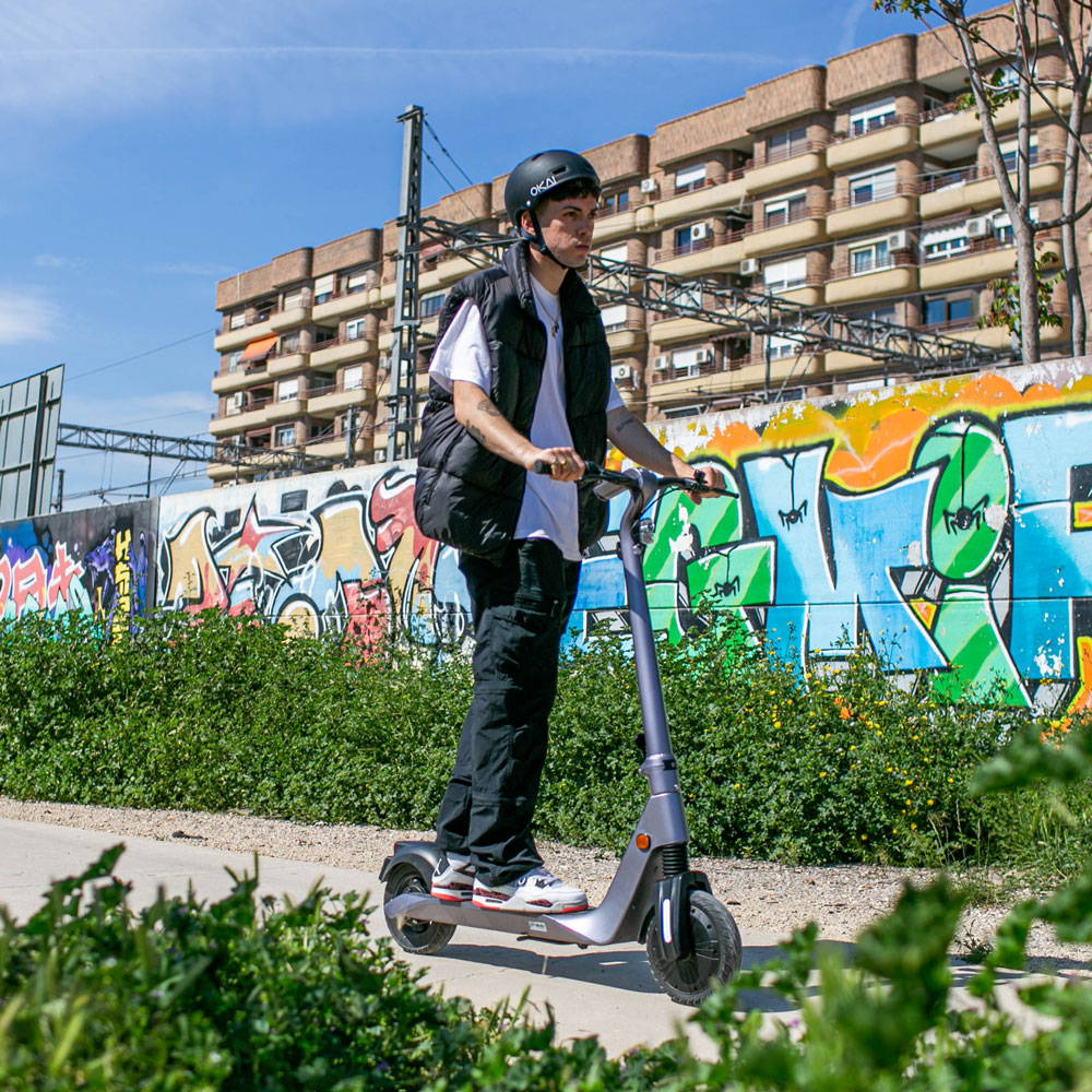Okai Es500 escooter man riding rough terrain street