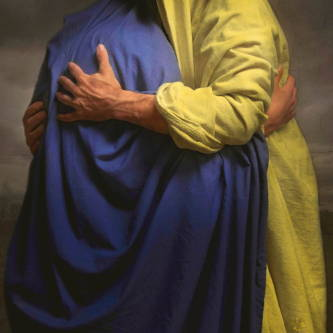 Jesus embracing an individual in a blue robe.