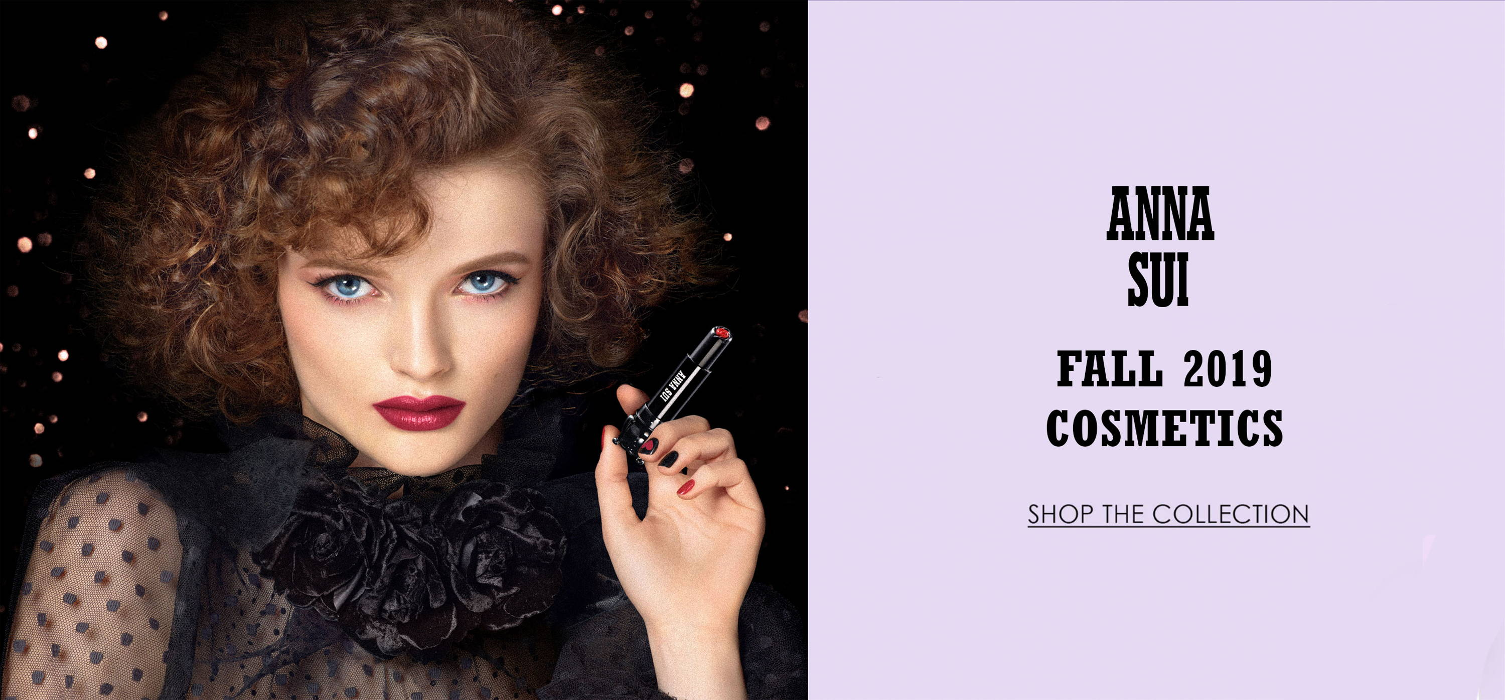 Anna Sui Fall 2019 cosmetics photo starring a model holding lipstick. Click to shop the collection