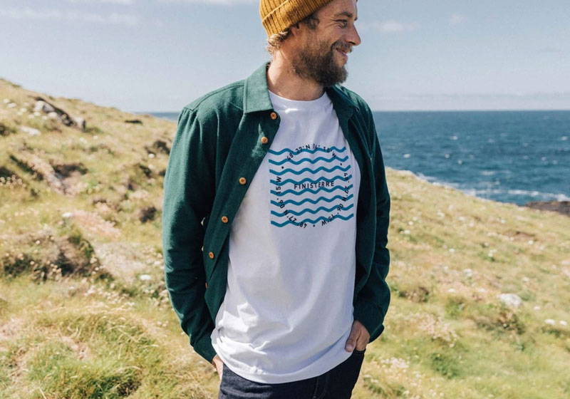 Man wearing green organic cotton shirt from Finisterre