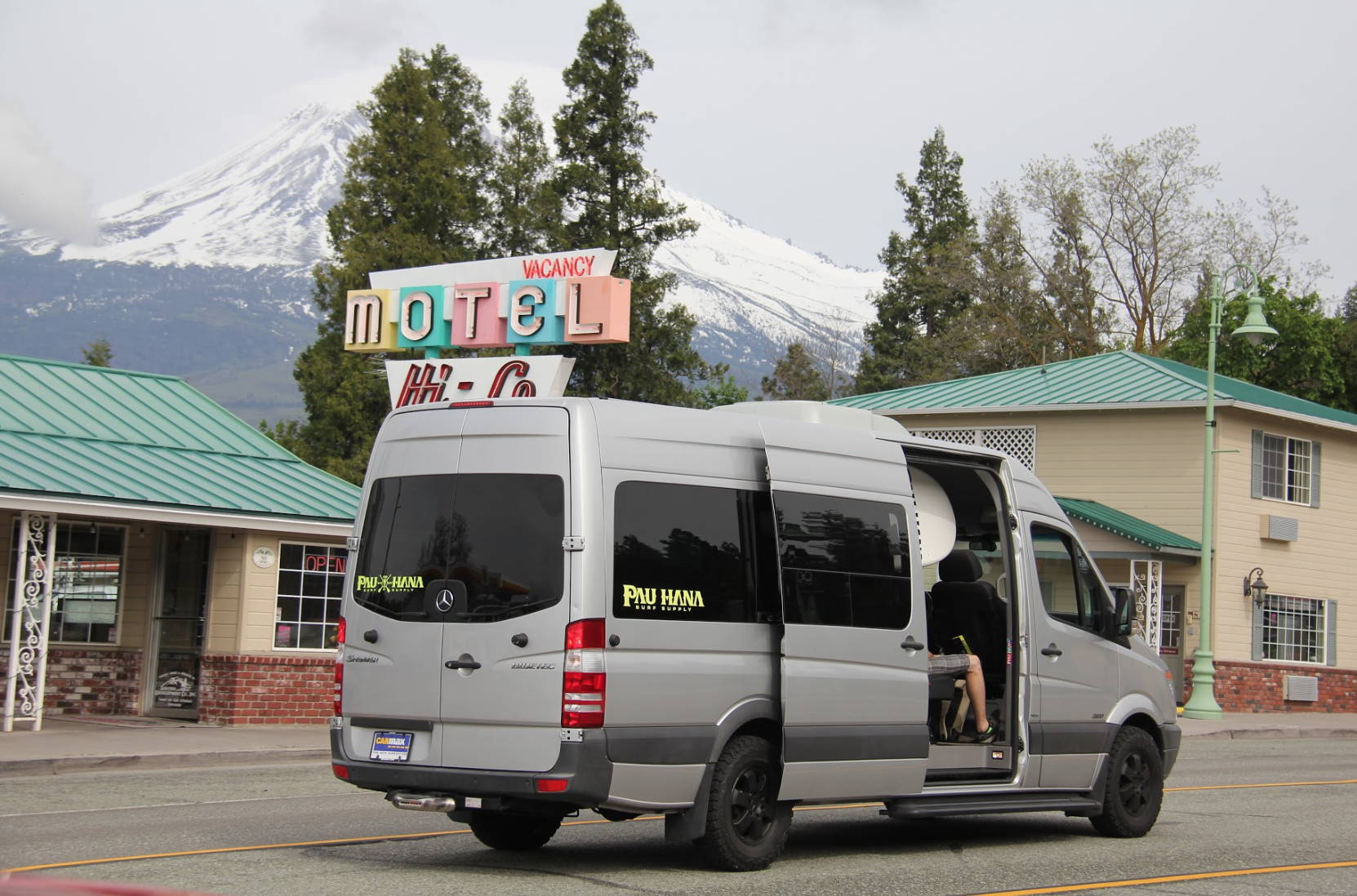 Pau Hana sprinter van passing a motel in bend Oregon