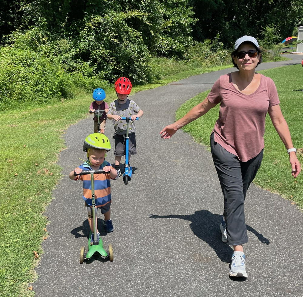 Randee on a walk with her 3 grandkids