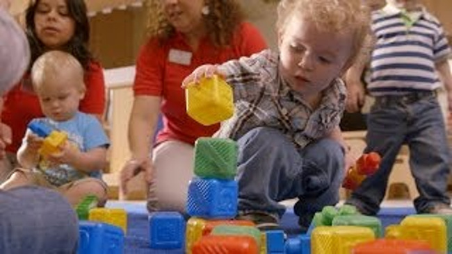 toddlers stacking blocks