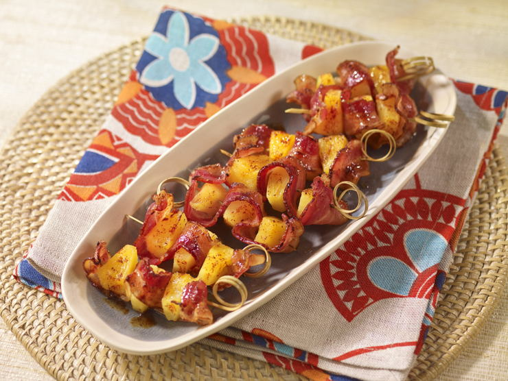 Image may contain: Bacon Wrapped Pineapple Bites recipe.