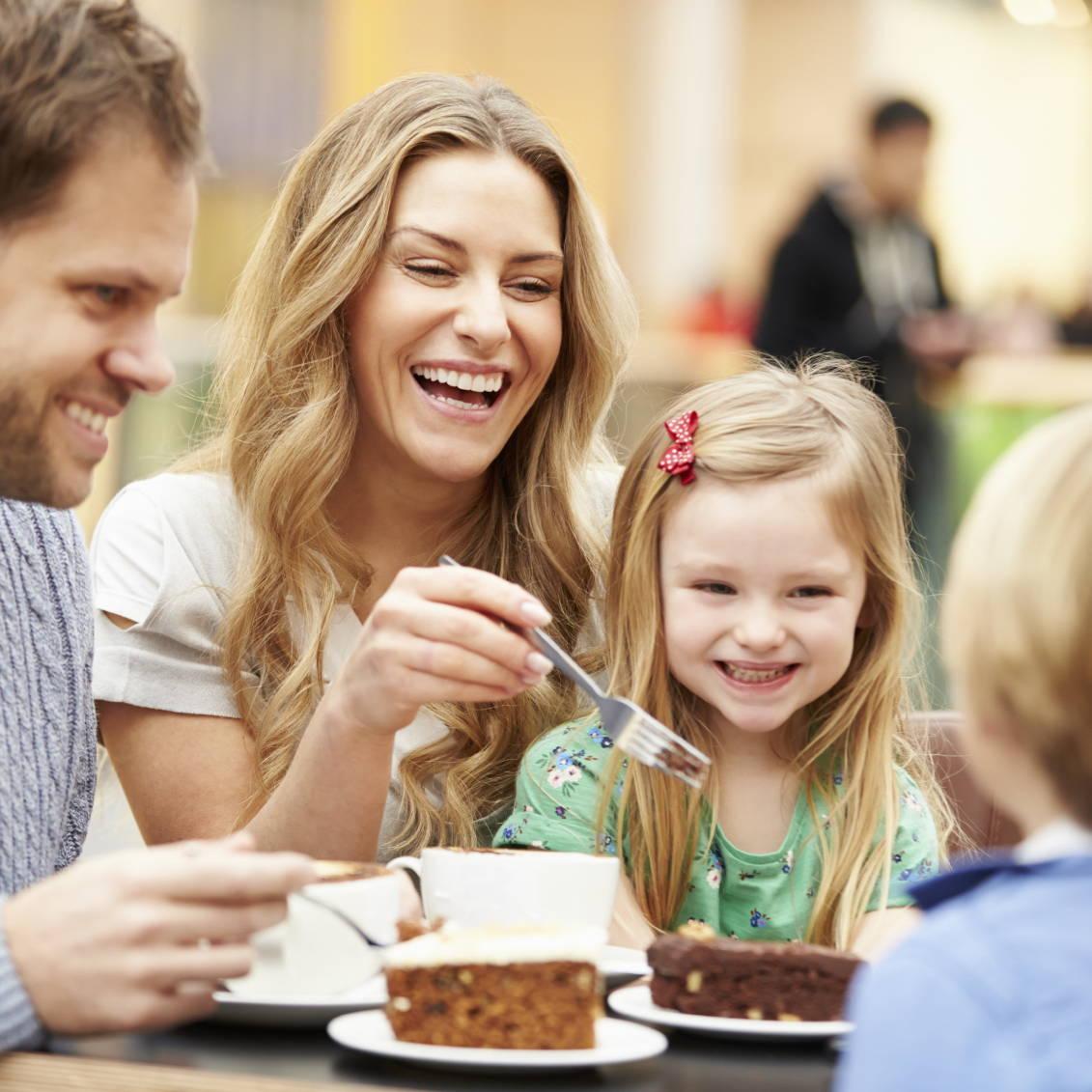 Family of four eating desert