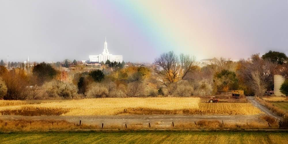 LDS art panoramic photo of the Mt Timpanogos Temple in the distance behind fall fields and a rainbow.