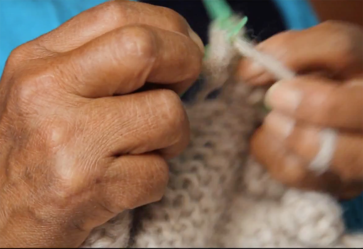 Hand detail of textile artisan woman in Peru