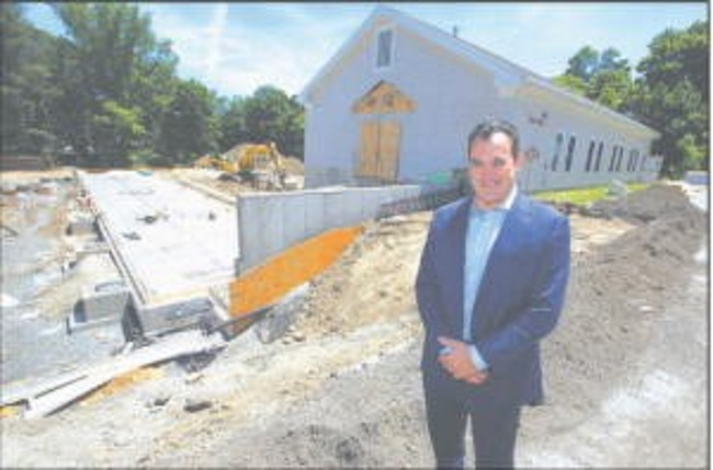 Rob Parsons poses outside of Primrose school of Chelmsford under construction