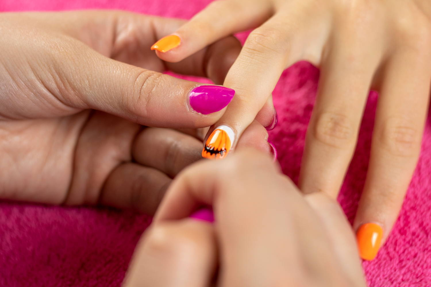 Pumpkin mouth being painted onto nails using ORLY Liquid Vinyl