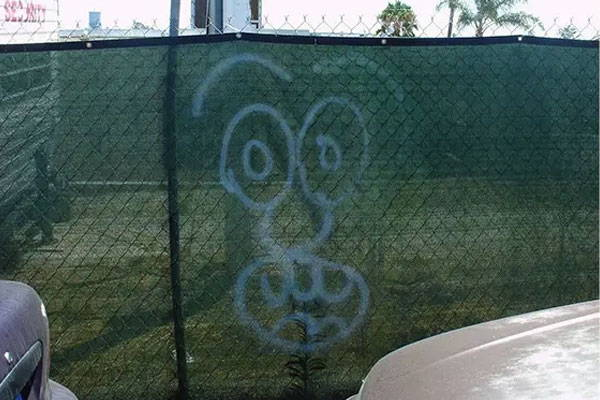 graffiti on hurricane and netted fencing