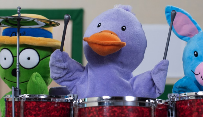 Primrose Friend Billy the duck playing the drums