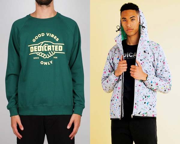 Man wearing green printed organic cotton hoodie and man wearing recycled polyester jacket and black t-shirt and trousers