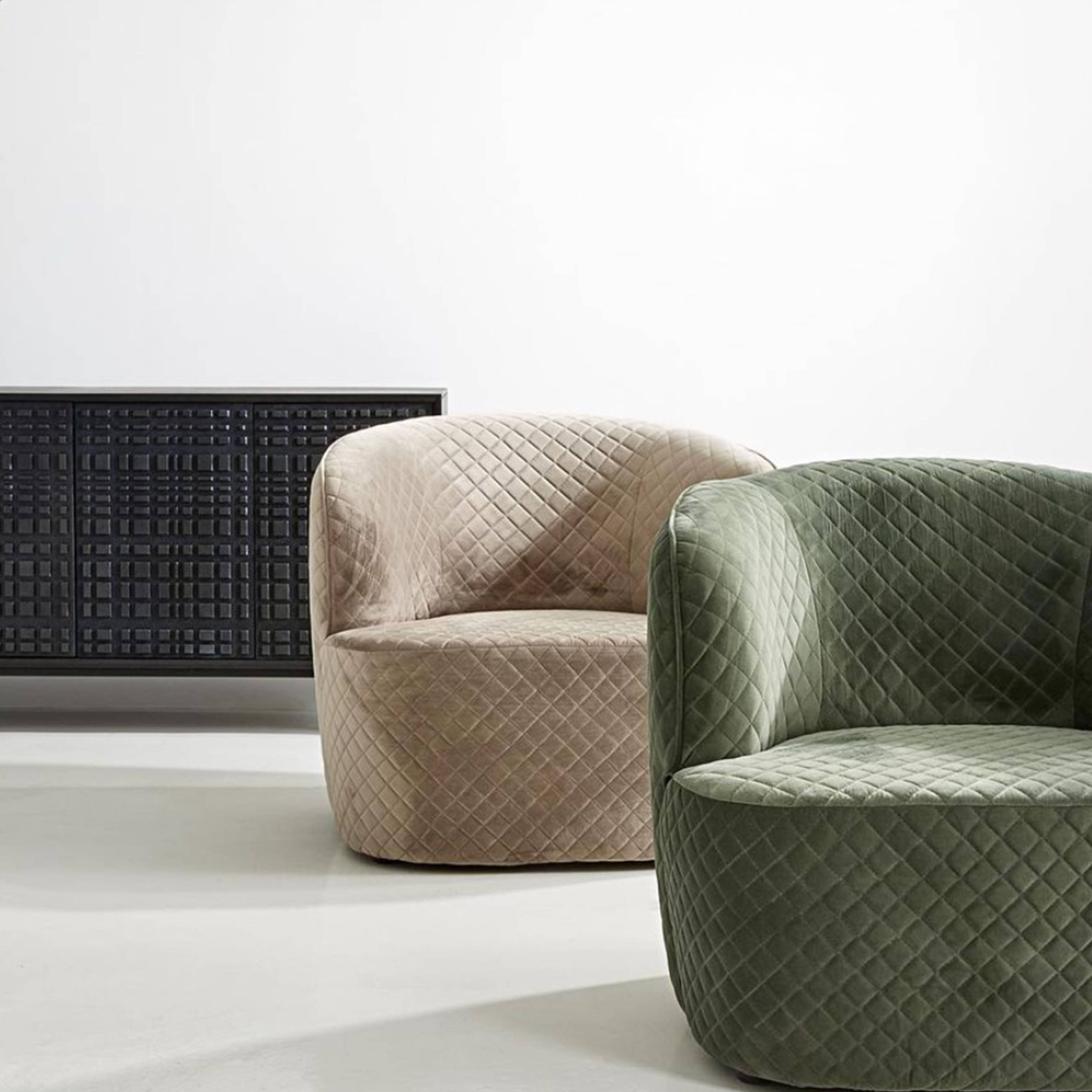 Occasional Chairs by Horgans - An image with two rounded armchairs in a neutral beige and an olive green