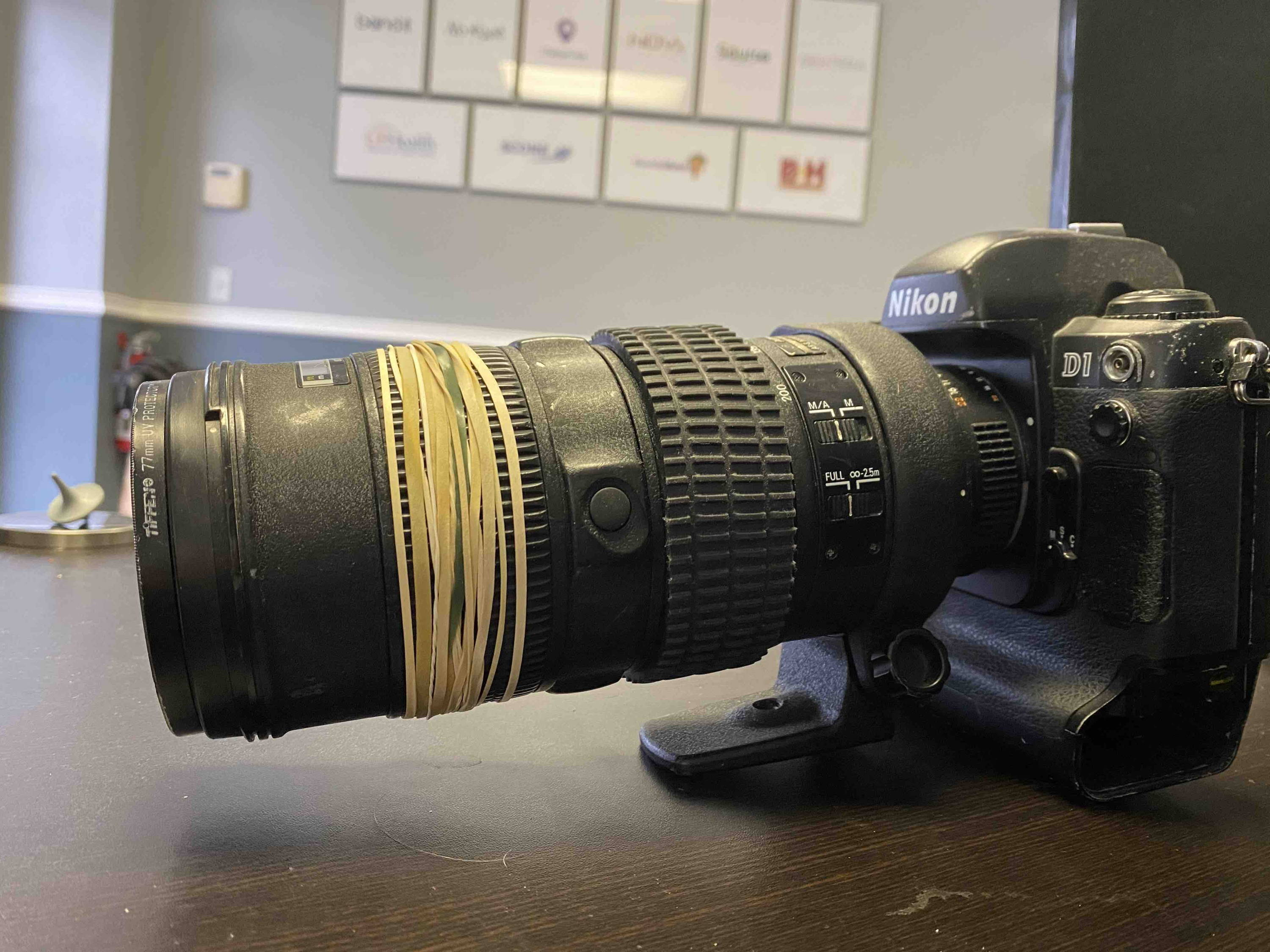 rubber bands on a camera lens