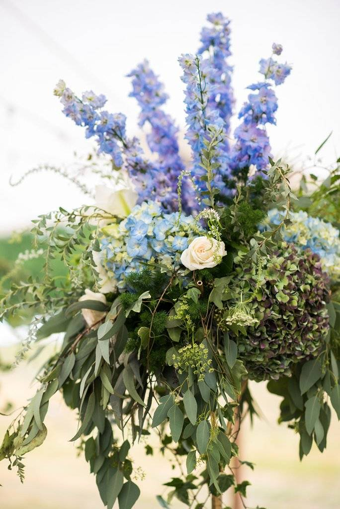 sperry tent wedding with blue and green flowers | Finger Lakes Wedding Florist