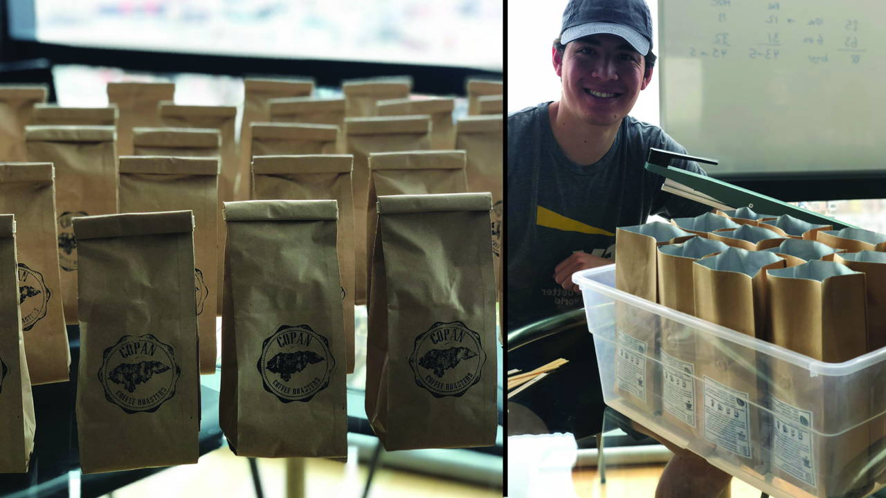 Multiple bags of coffee on left, our company master roaster, Harry, on right.