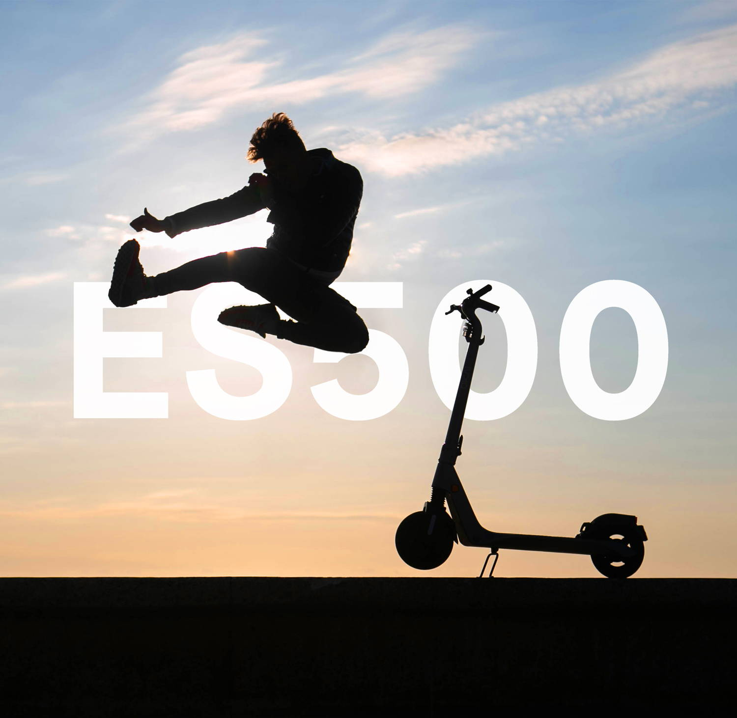 Okai ES500 E-Scooter man jumping sunset scooter