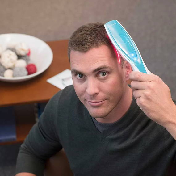 Man using laser light therapy for hair loss