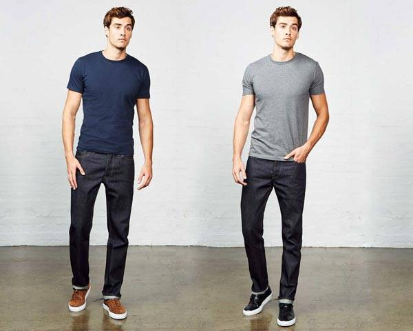 Man wearing organic cotton dark indigo jeans from Hiut Denim