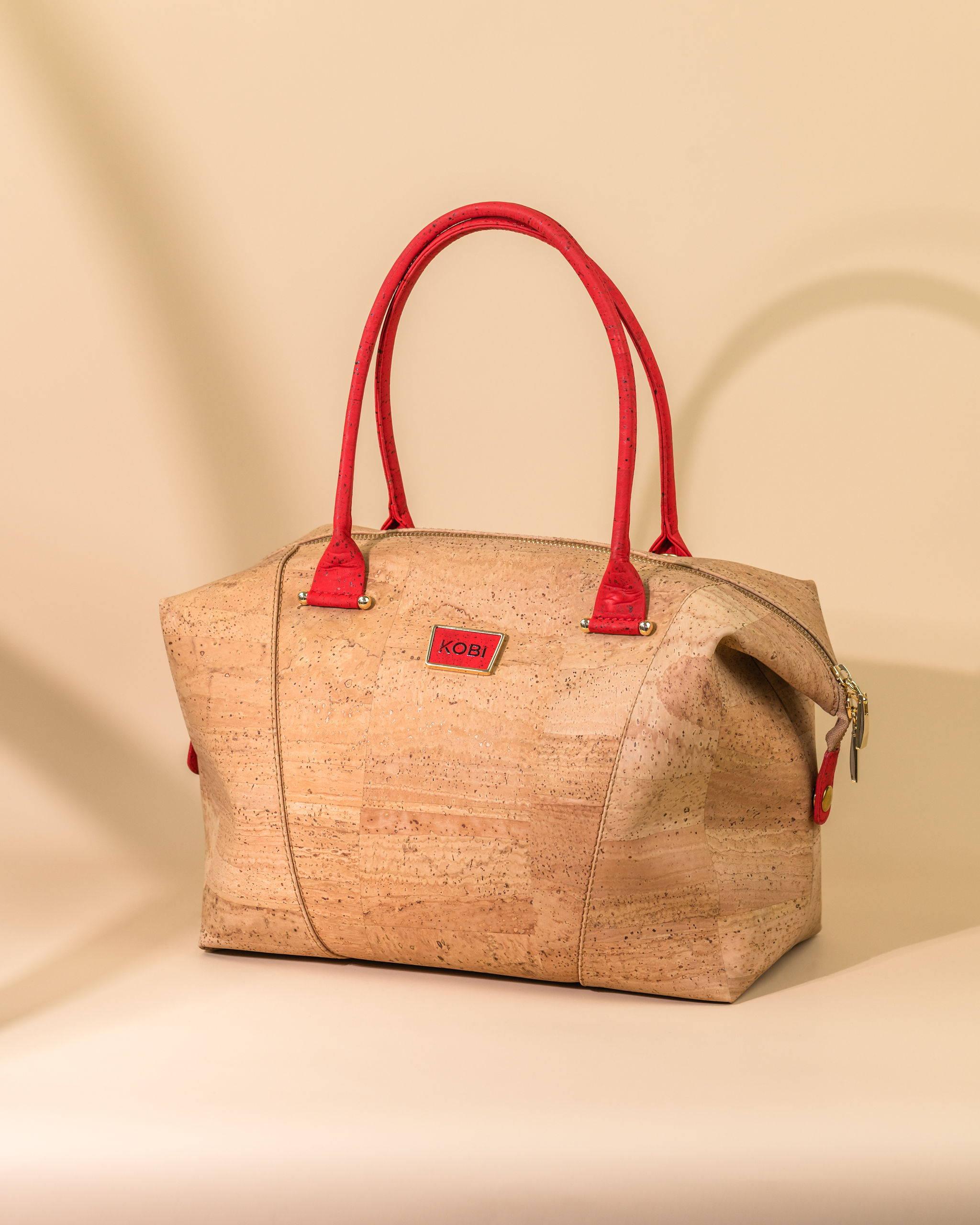Natural cork bowler bag with red handles and KOBI branding