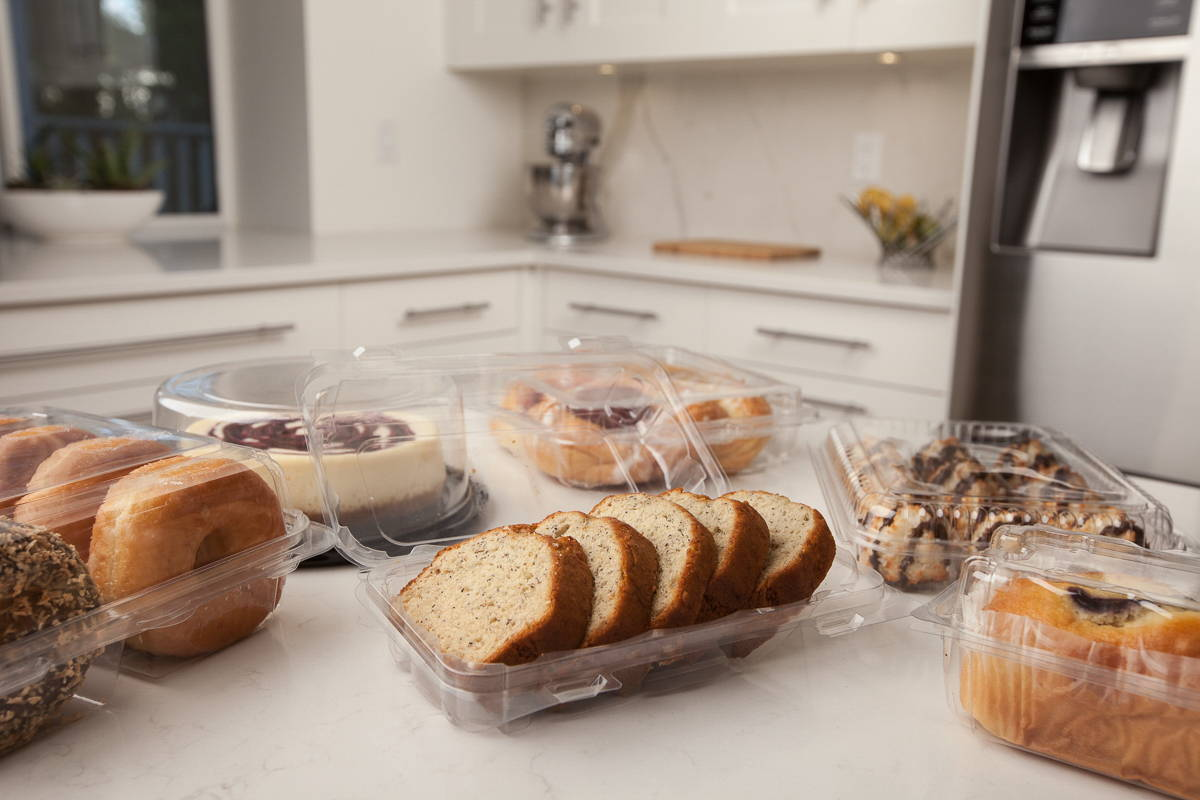 compostable carry-out and deli containers by Canadian bioplastic company filled with treats