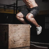 Man doing box jumps