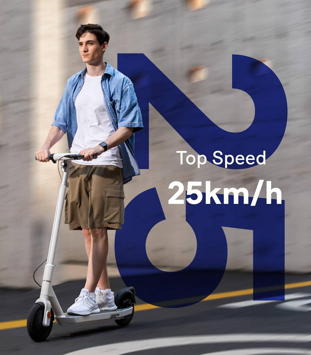 okai neon es20 25kmh escooter guy riding fast blur