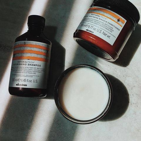 Davines Naturaltech hair products in sunlight and shadow