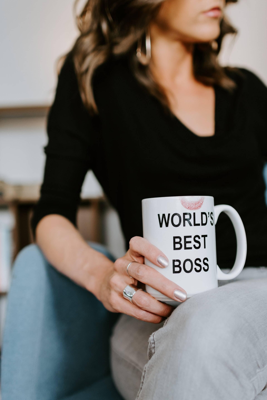 "Woman holding a mug with ""world's best boss"" written on"