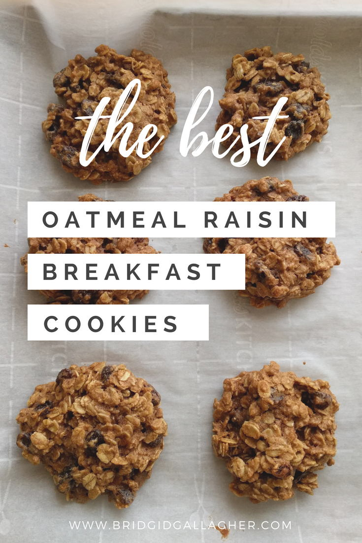 The Best Oatmeal Raisin Breakfast Cookies Recipe - Photo of six oatmeal raisin breakfast cookies on a baking sheet covered with parchment paper - recipe on www.bridgidgallagher.com